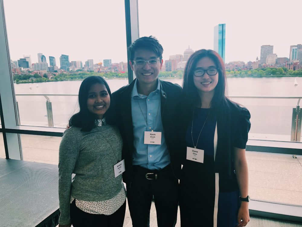 Ananya N. '19, Diane Z. '19, and the blogger smiling in front of views of the Boston skyline.