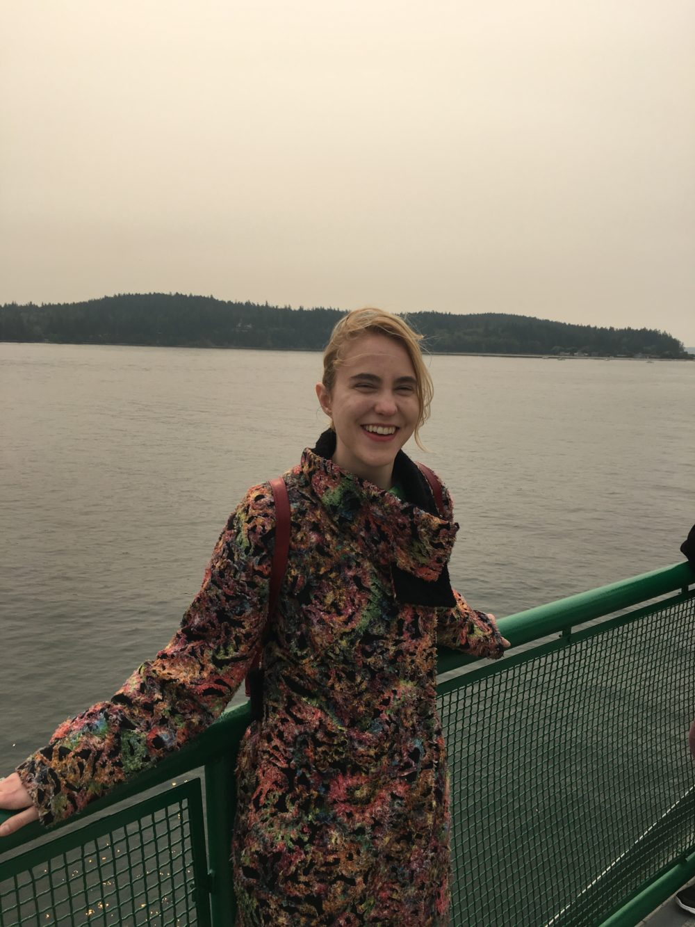 Me on a ferry on the water. It's very smoky.