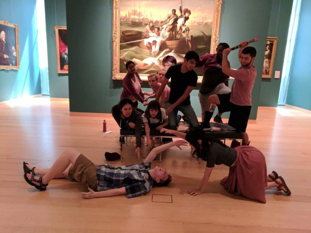 the counselors recreating a painting at a museum of a man being attacked by a shark