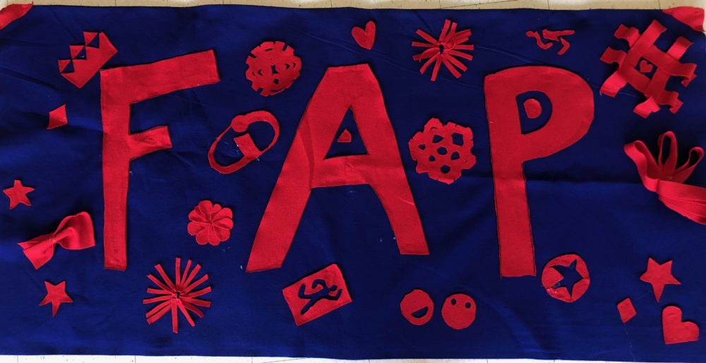 This is the FAP sign. It has big letters for F A P decorated with many random things (from flowers to the incredibles logo (referencing the 2022s orientation theme) to snowflakes around it.