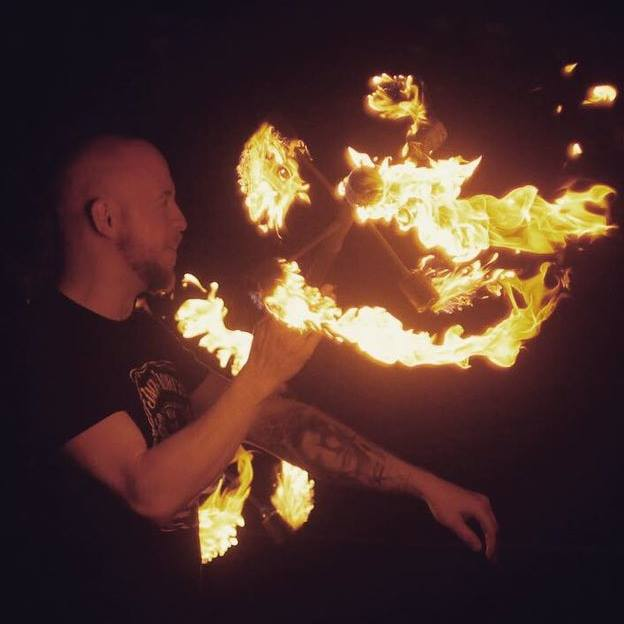 a picture of me spinning a dragon staff that is also on fire