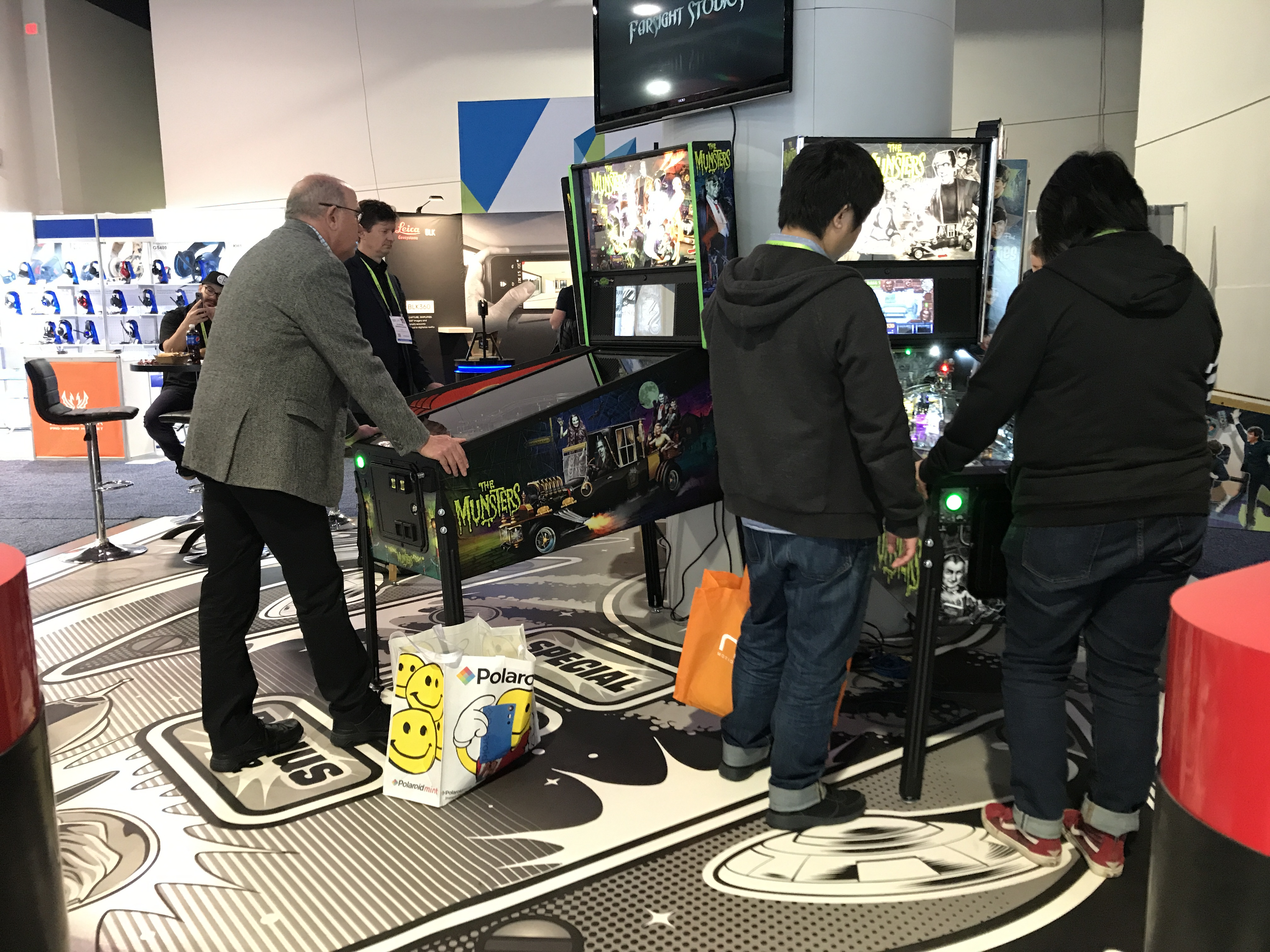 ces attendees playing arcade games