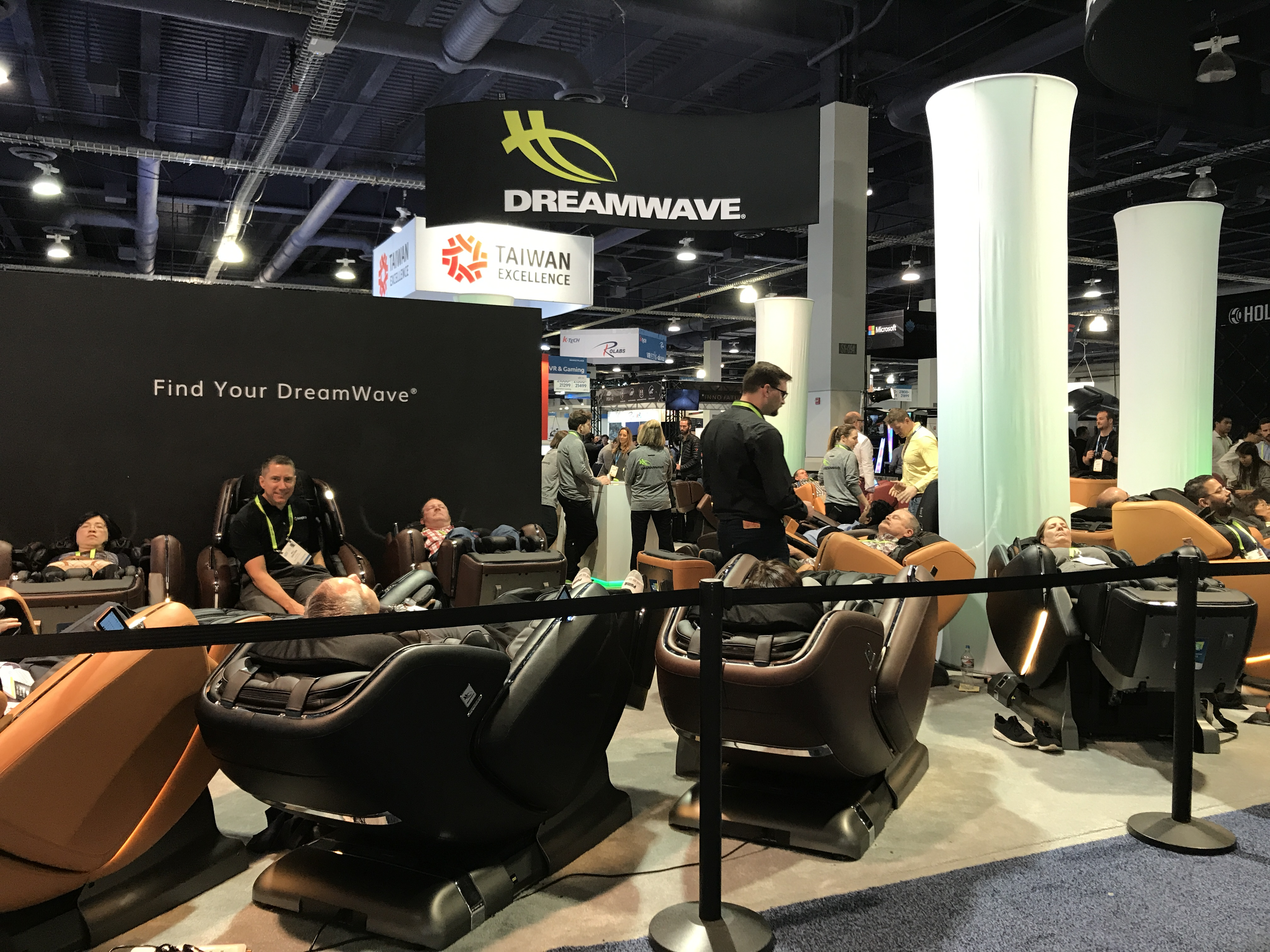 people in massage chairs at ces