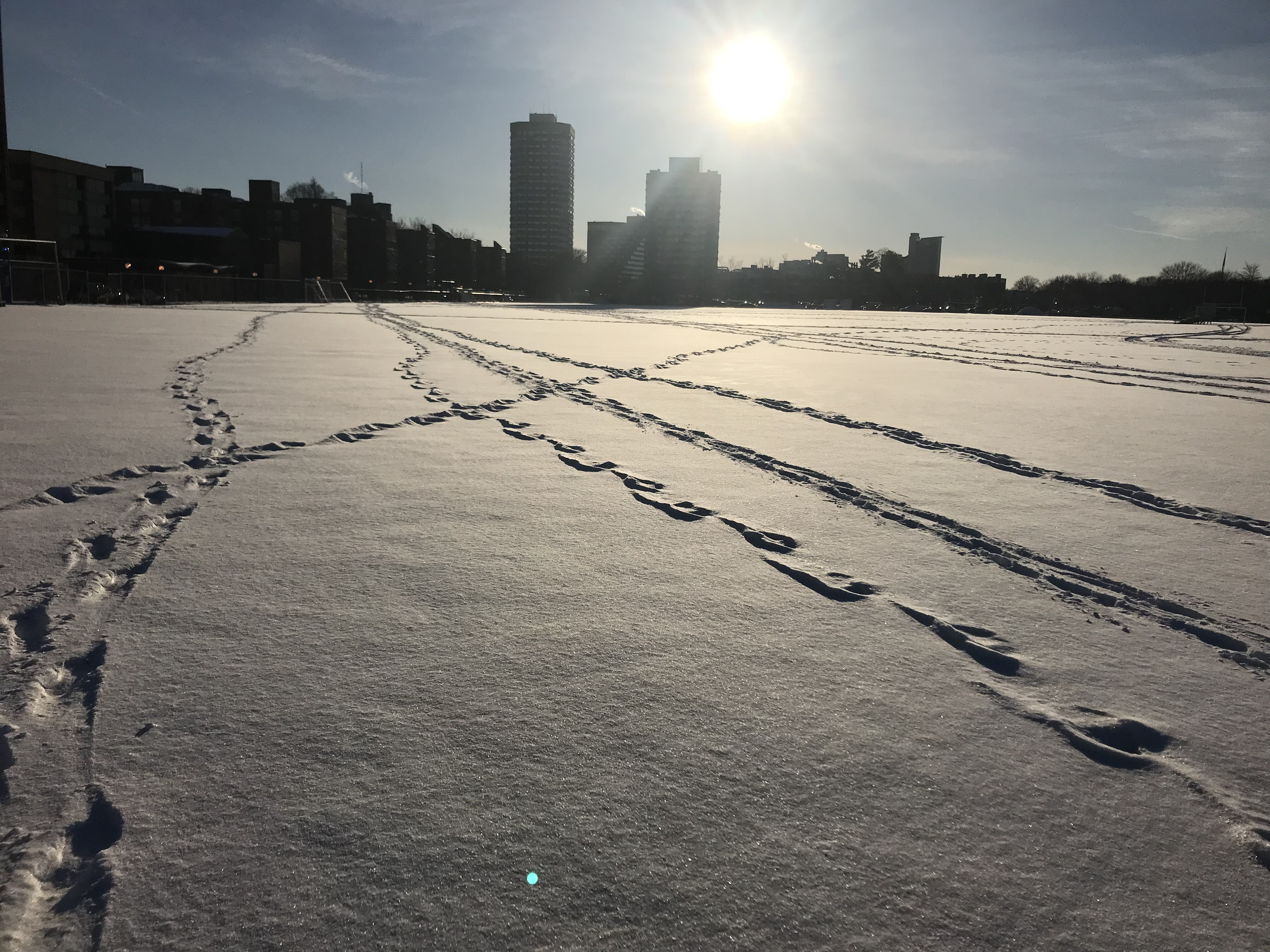snow on the football field with footprints