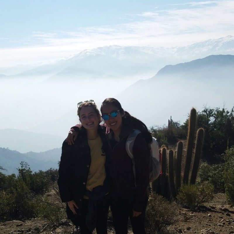 me, my housemate, and snow-covered Andes mountains