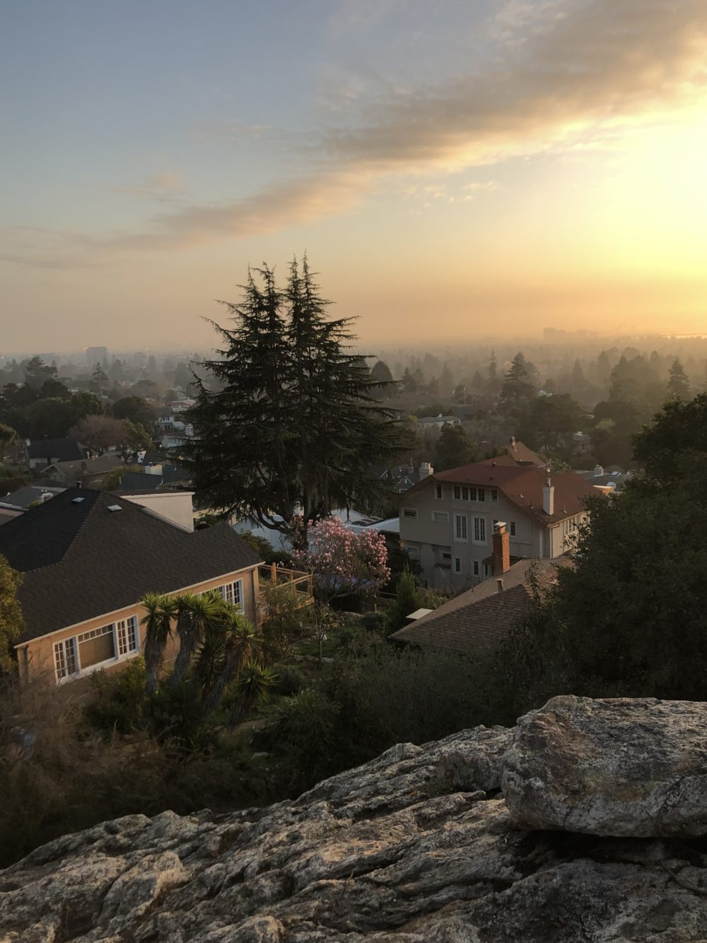 park 2 (rocky cliff, with houses, trees and fog in the distance, and the sun setting)