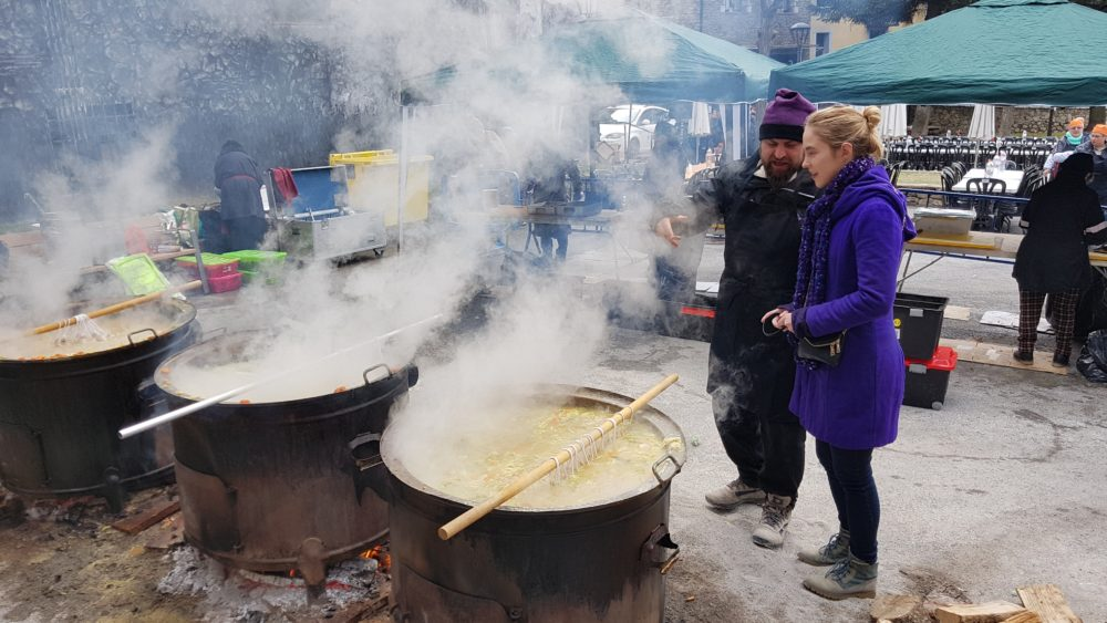 Many giant cauldrons of steaming soup in the Encamp town center
