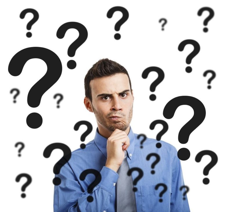 stock photo man surrounded by question marks