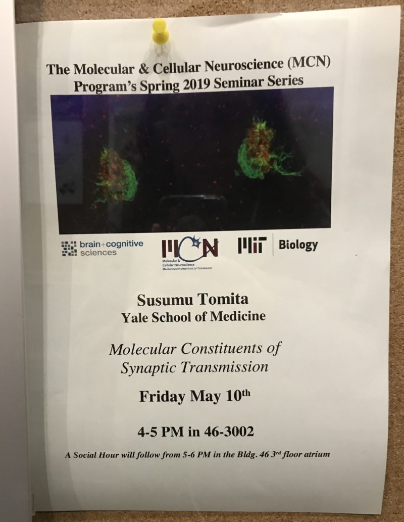 a poster advertising a Susumu Tomita molecular and cellular neuroscience seminar entitled molecular constituents of synaptic transmission