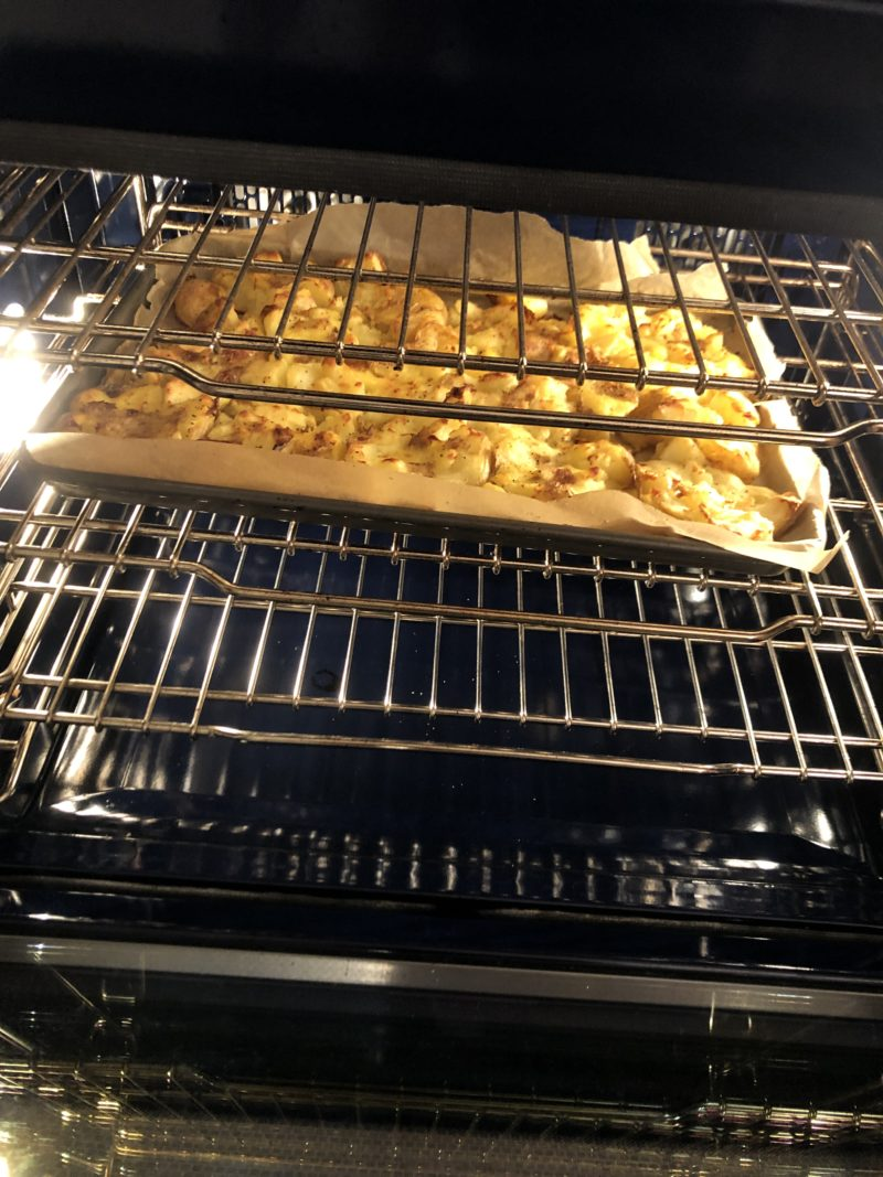 image of smashed potatoes in oven