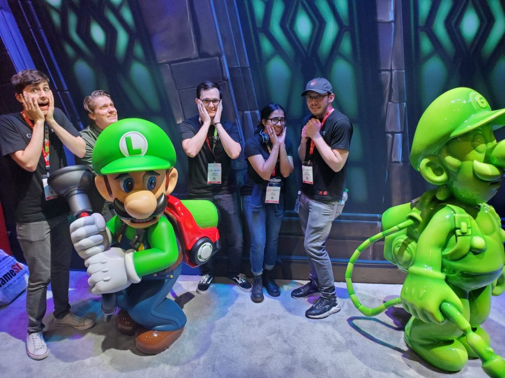 interns being scared with luigi outside the luigi's mansion exhibit