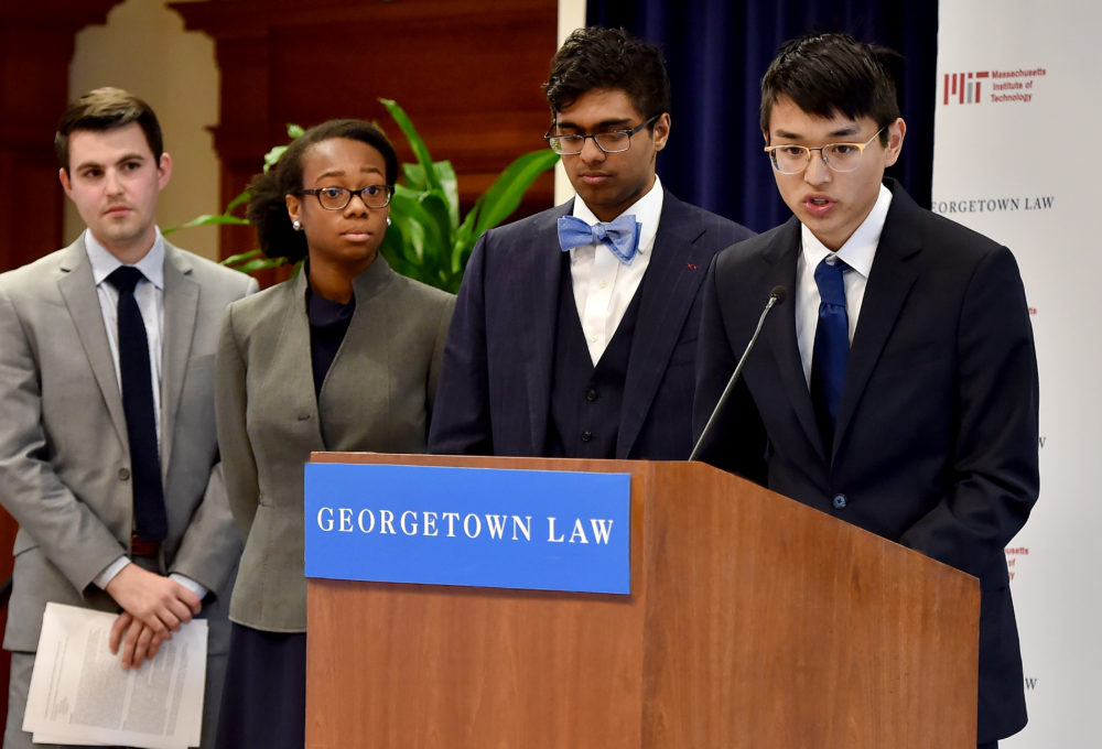 me speaking on a podium at Georgetown law