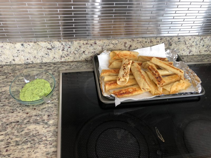 picture of taquitos and green sauce