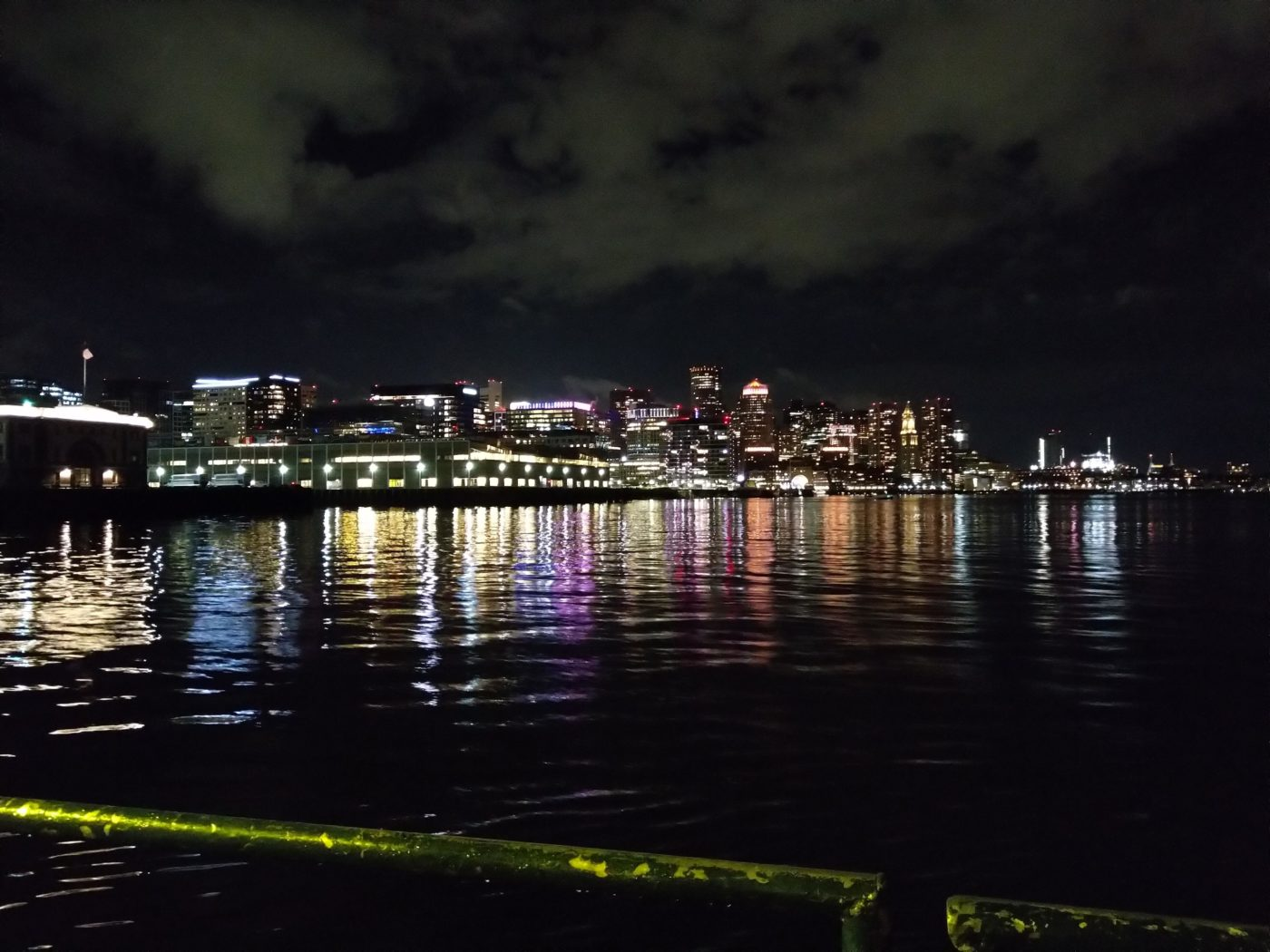 A picture of the Boston skyline from a boat.