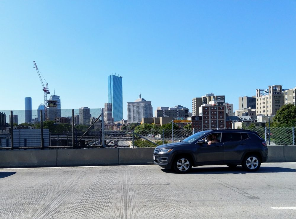 a boston skyline, as viewed from the highway