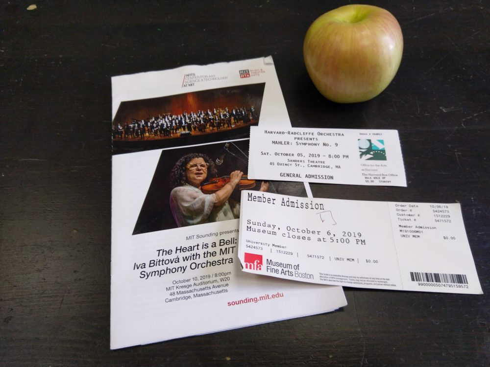 an apple, two tickets, and a pamphlet
