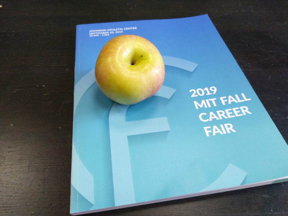 an apple on a career fair booklet