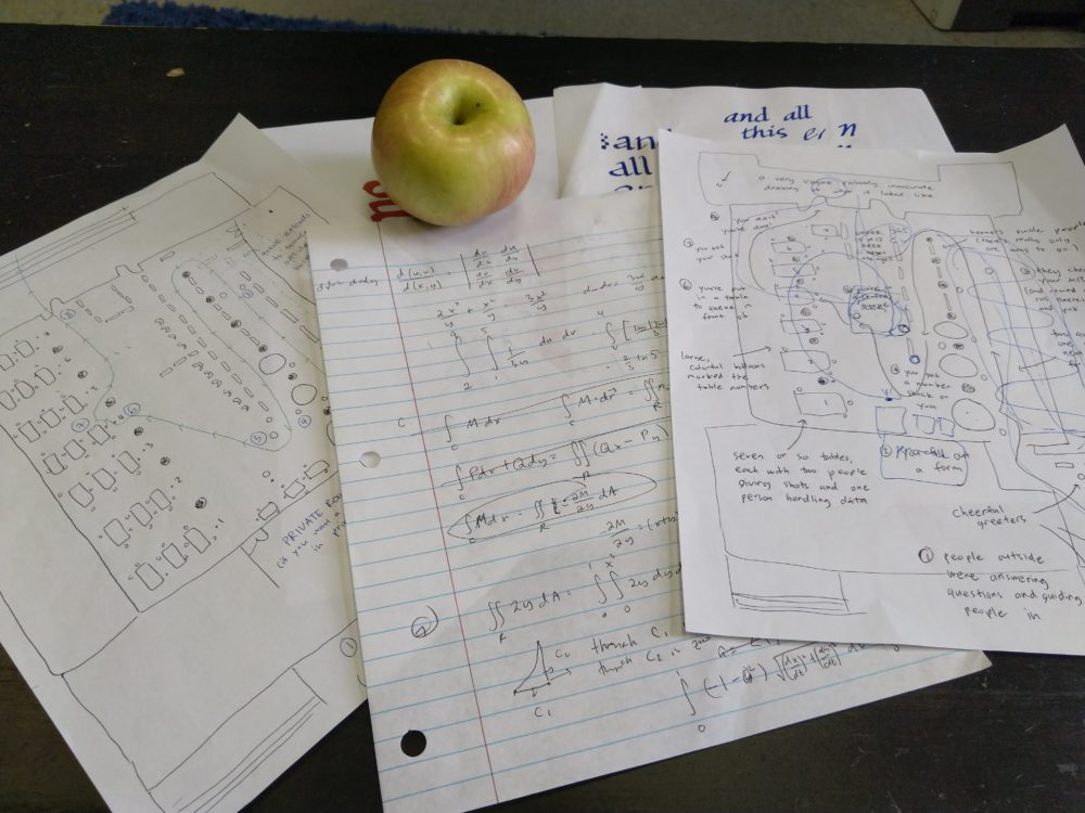an apple. and scrap paper