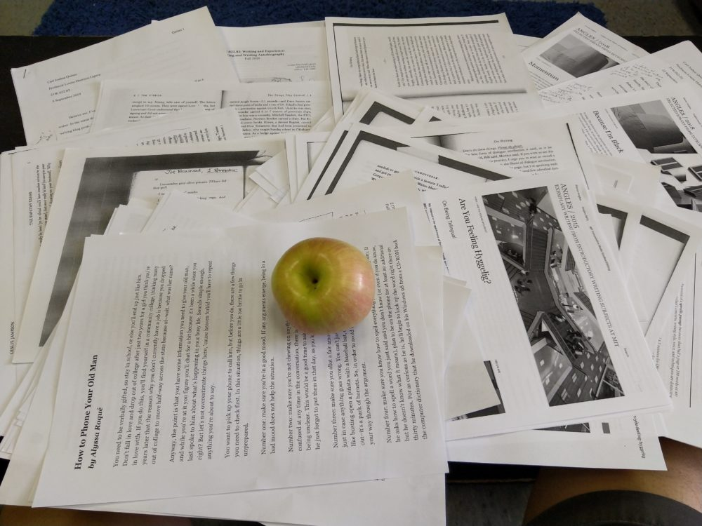 an apple over LOTS of papers