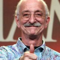 picture of woodie flowers giving a thumbs up