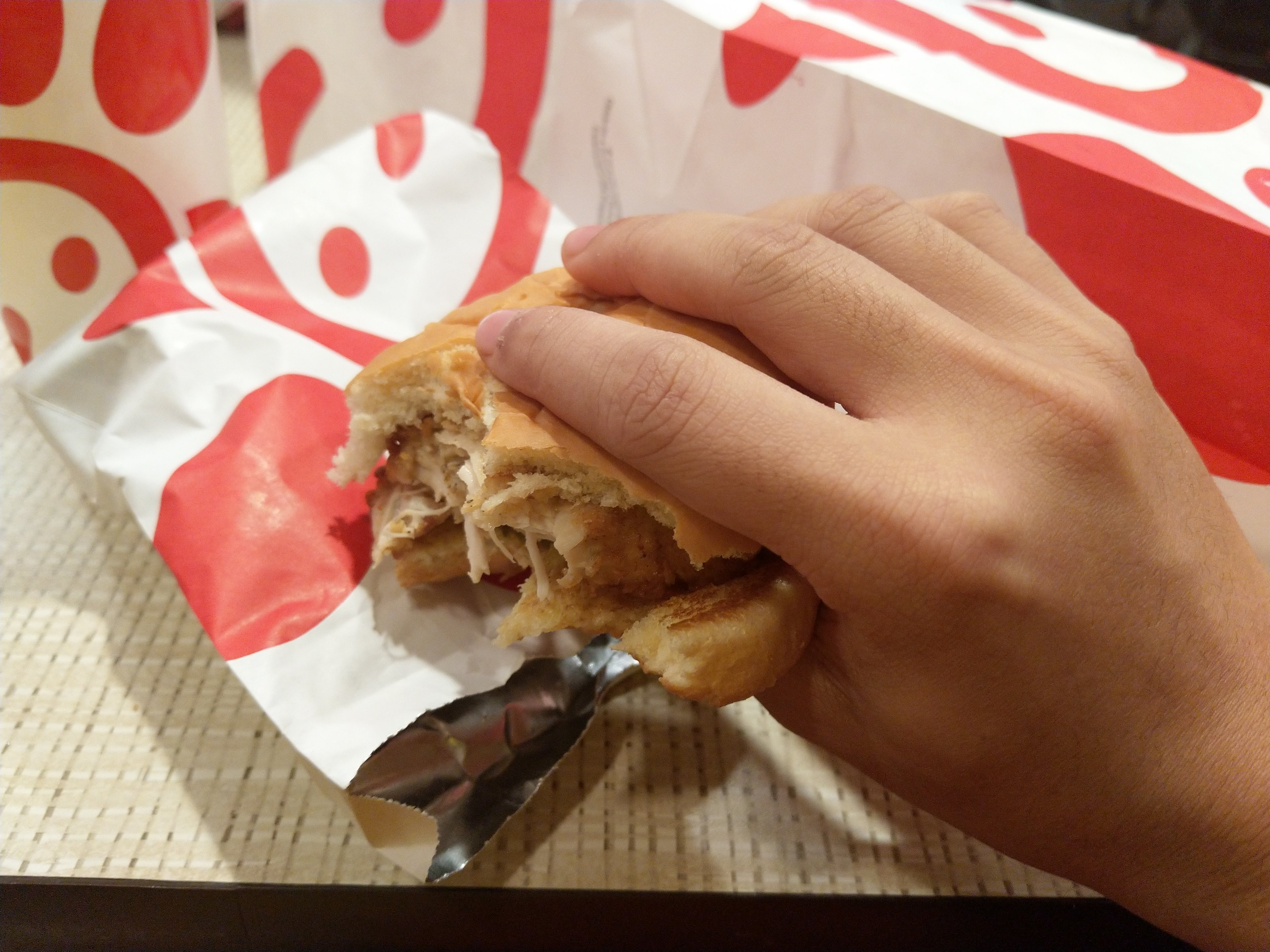 a half-finished chick fil a sandwich