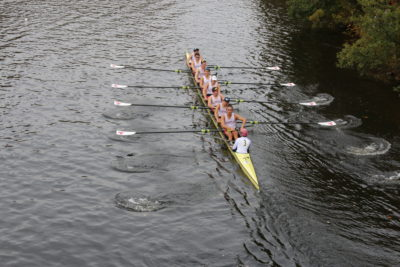 a rowing shell with MIT oars