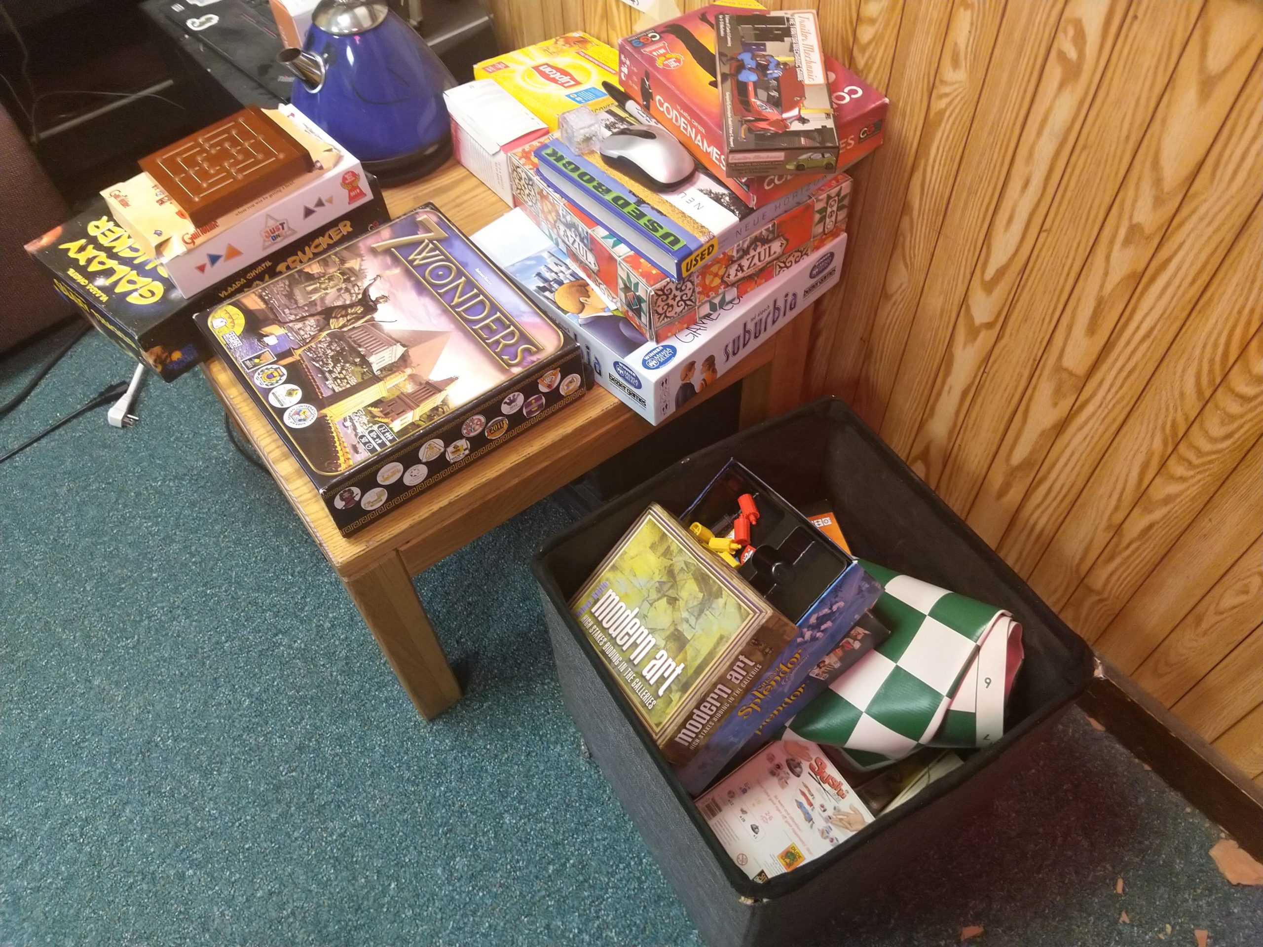 boxes of board games, on a table, and in a box