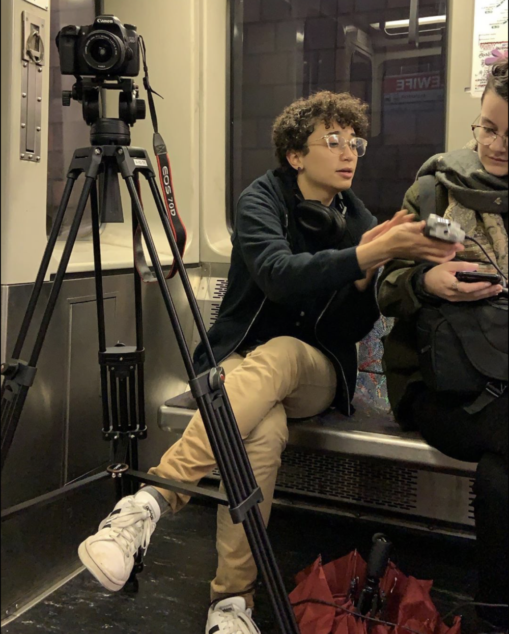a picture of me and a tripod/camera set up on the train car