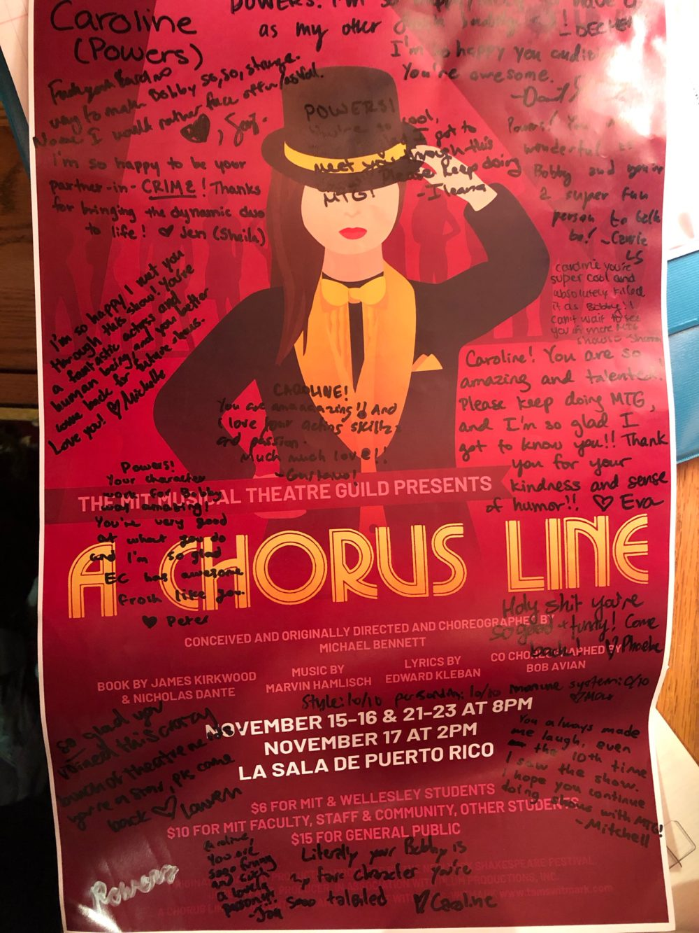 a poster for the show with many personalized messages written on it in sharpie