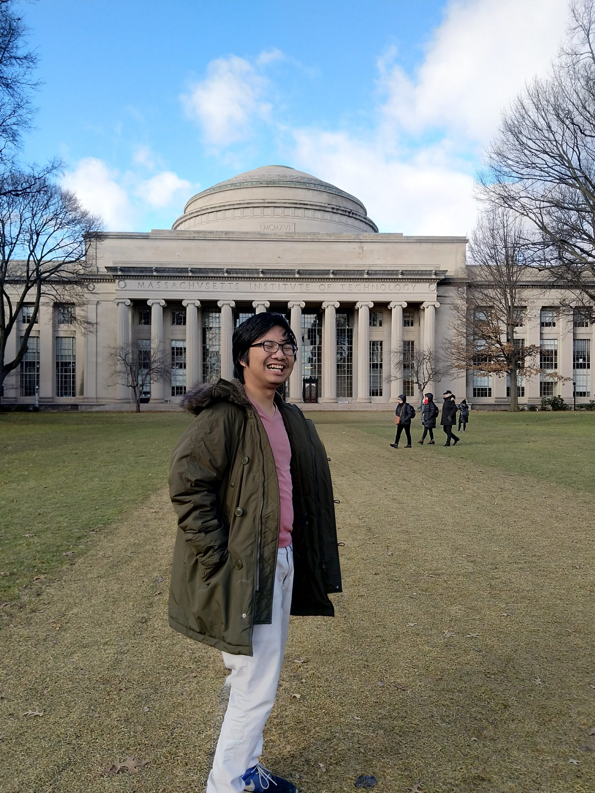 me, smiling, standing in front of the mit's dome