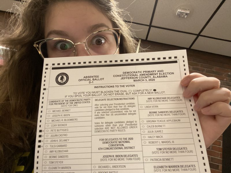 me holding up my absentee ballot