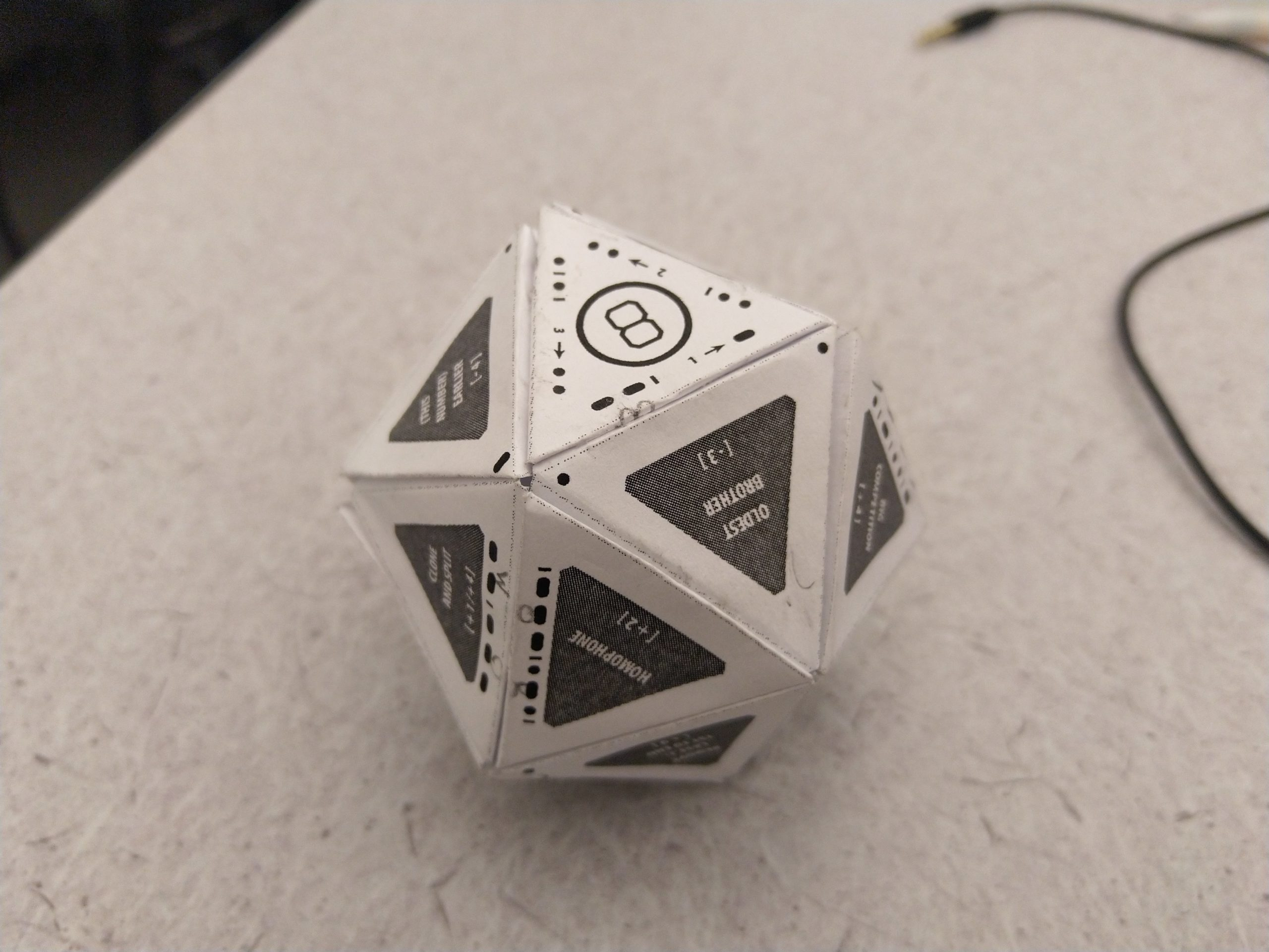 an assembled icosahedron from paper on a table