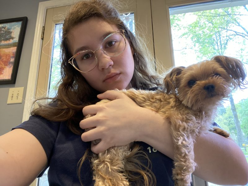 me holding a dog