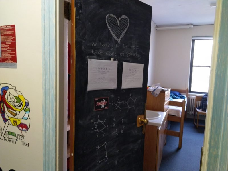 "my door after packing some stuff. everything in the past picture is erased. there's a drawing of a heart on top, and ""i'm hoping for the best, take care of yourselves"" written underneath."