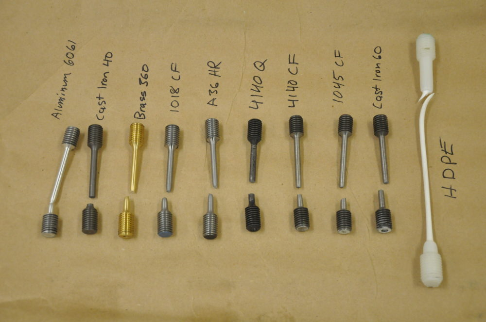 a photo of 10 different rods, all recently broken during testing
