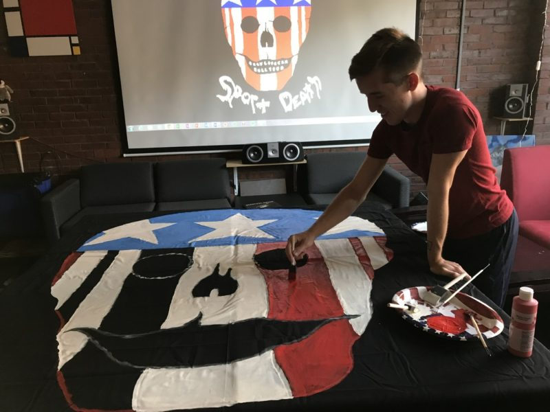 painting a skull on a solidarity banner