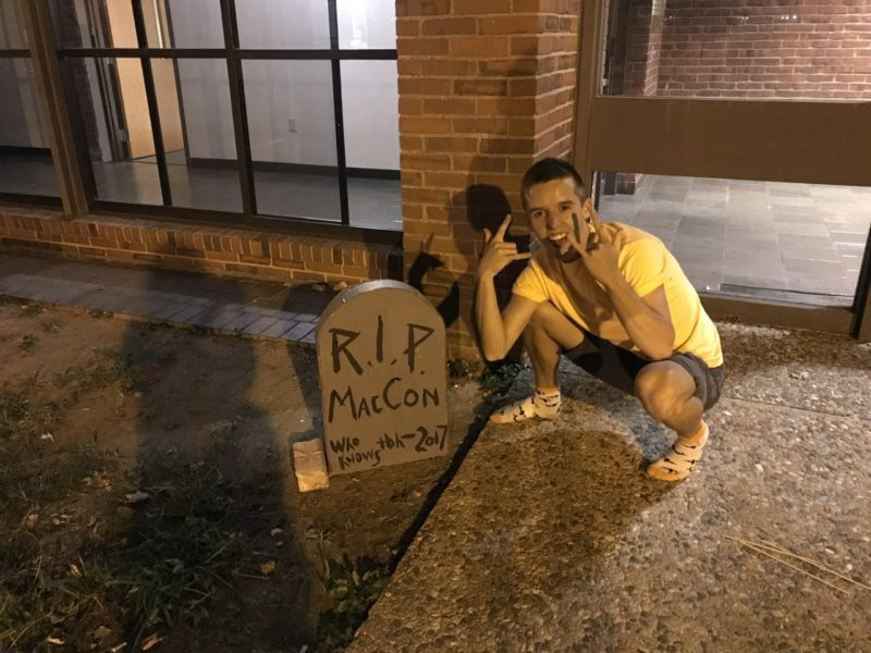 a cardboard tombstone that says rip mac-con