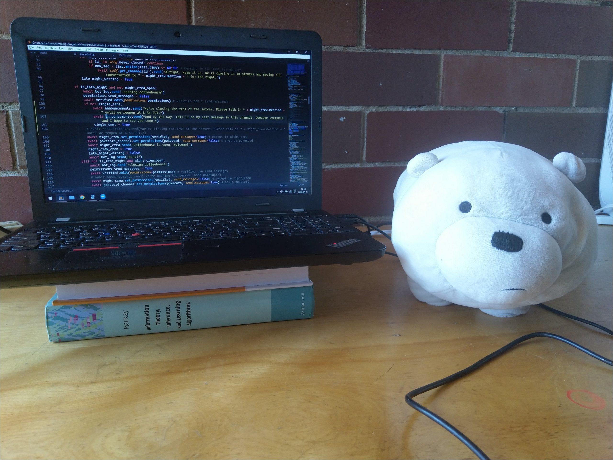 ice bear on my desk next to my laptop
