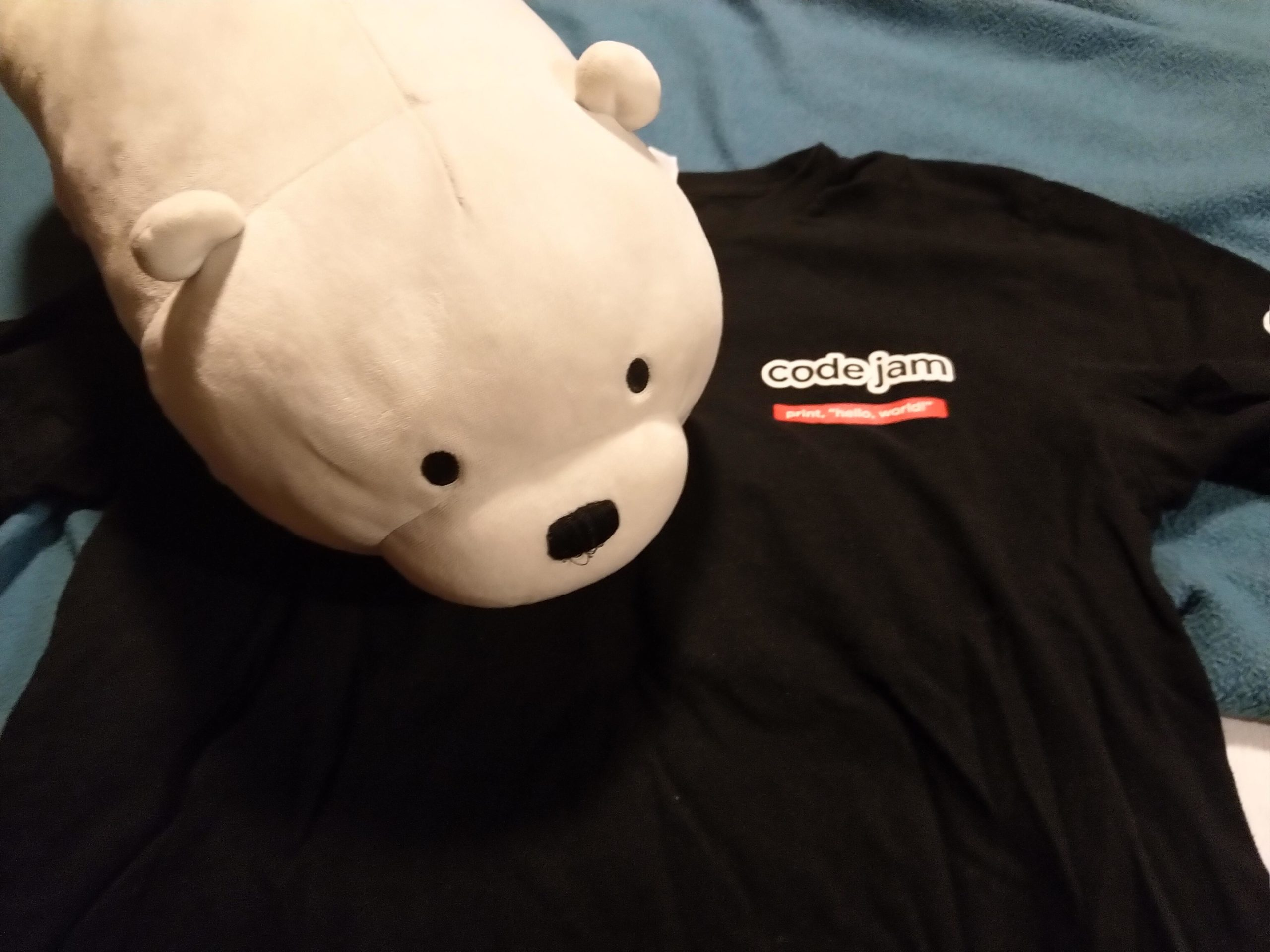 "ice bear on my code jam tshirt. a black shirt with ""code jam"" written on front"