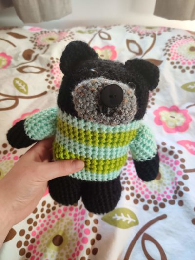 knitted bear in a sweater