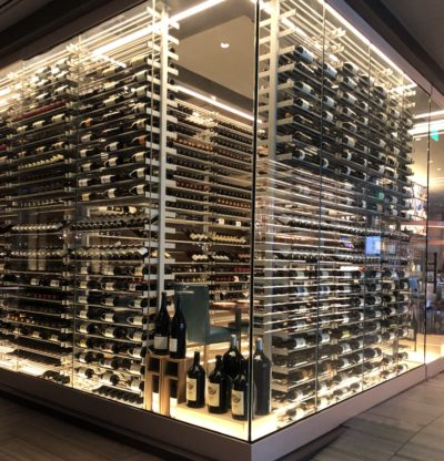 glass box with tons of wine