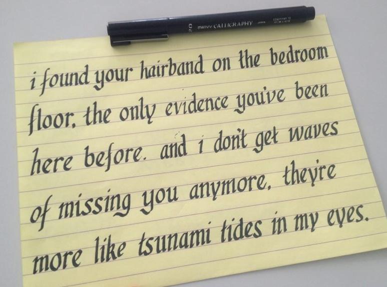 the opening lyrics to ed sheeran's UNI, written in kinda bad calligraphy, on a yellow sheet of paper