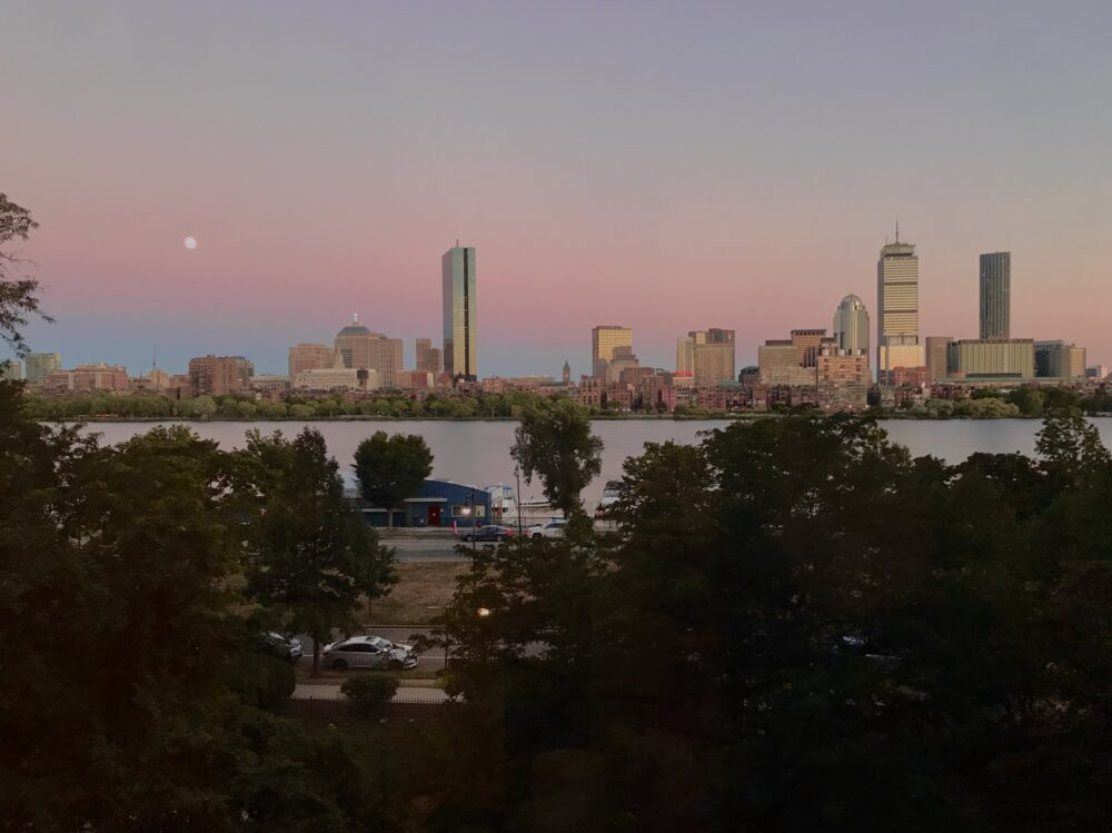 The view of the Charles River and the Boston skyline at sunset from my apartment.