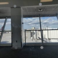 view of planes through an airport glass wall