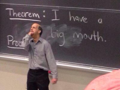 """bjorn poonen in front of a blackboard with his hand all the way in his mouth as a proof of the theorem """"i have a big mouth"""""""