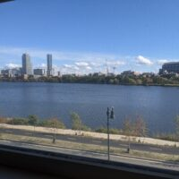 a picture of the boston skyline and charles river from my window
