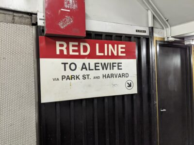 "sign reading: ""Red Line to Alewife via Park Street and Harvard"""
