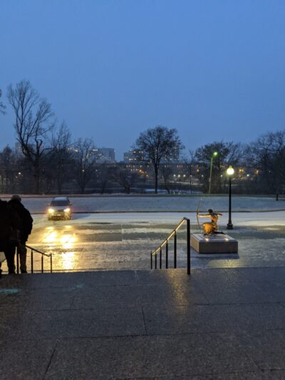 a thin layer of snow blankets the ground in front of the museum of fine arts
