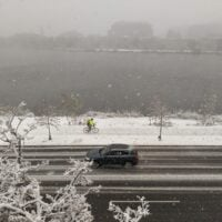 snow on memorial drive, looking out at the charles river