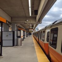 another shot of two orange line trains at oak grove station